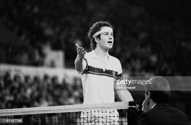 American tennis player John McEnroe talks to the referee during a match at the Benson Hedges Tennis Championships Wembley Arena London UK 13th...