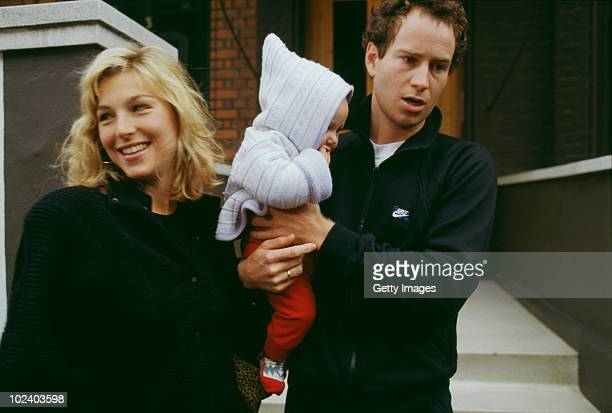 American tennis player John McEnroe with his wife actress Tatum O'Neal and one of their children circa 1987