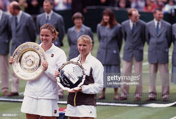 American tennis player Lindsay Davenport holds the Venus Rosewater Dish trophy after winning the final of the Women's Singles tournament against...