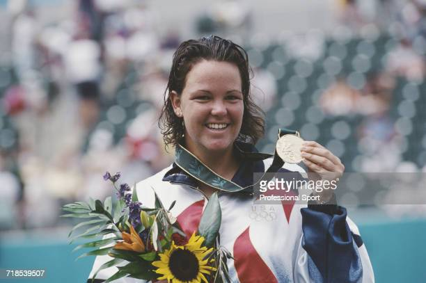 American tennis player Lindsay Davenport of the United States team stands on the podium after winning the gold medal in the women's singles tennis...