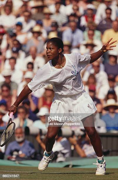 American tennis player Lori McNeil pictured in action during progress to reach the semifinals of the Ladies' Singles tournament at the Wimbledon Lawn...