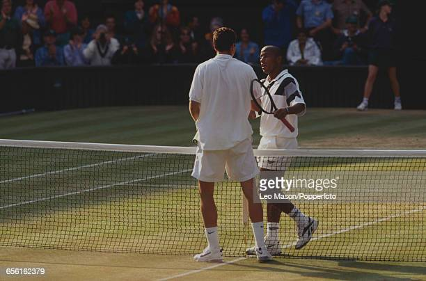 American tennis player MaliVai Washington shakes hands with Dutch tennis player Richard Krajicek after being defeated by Krajicek in the final of the...