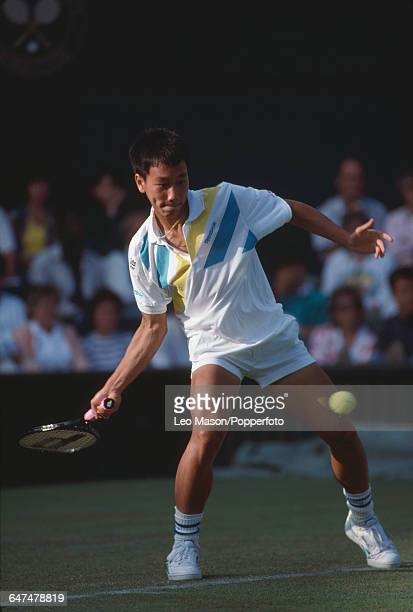 American tennis player Michael Chang pictured in action competing reach the fourth round of the Men's Singles tournament at the Wimbledon Lawn Tennis...