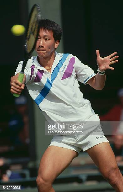American tennis player Michael Chang pictured in action competing to reach the fourth round in the Men's Singles tournament at the Wimbledon Lawn...
