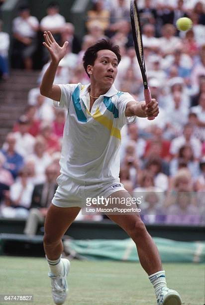 American tennis player Michael Chang pictured in action competing to reach the fourth round of the Men's Singles tournament at the Wimbledon Lawn...