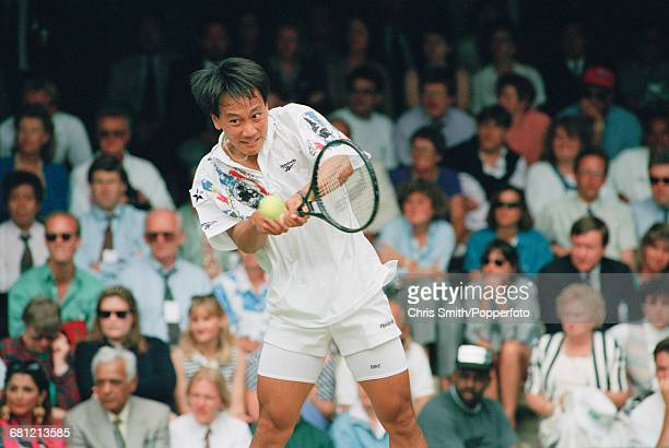 American tennis player Michael Chang pictured in action to reach the third round of the Men's Singles tournament at the Wimbledon Lawn Tennis...