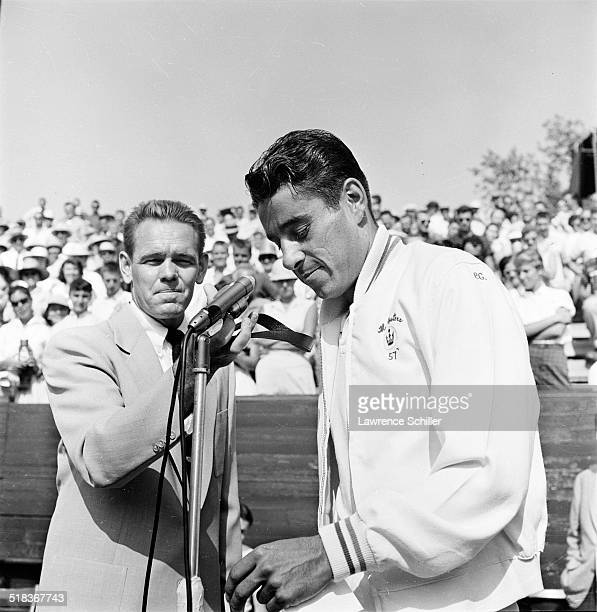 American tennis player Pancho Gonzales and former player Jack Kramer stand at a microphone during a tournament arranged by Kramer Los Angeles...