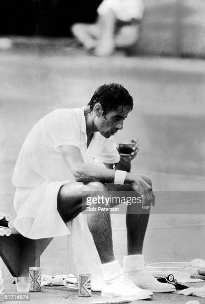 American tennis player Pancho Gonzales sits on a bench and drinks from a cup after a match at Forest Hills tennis stadium Queens New York New York...
