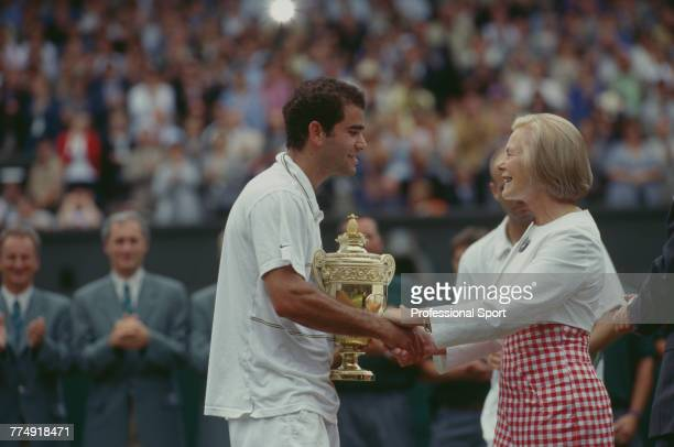 American tennis player Pete Sampras holds the Gentlemen's Singles Trophy as he shakes hands with Katharine, Duchess of Kent after beating fellow...
