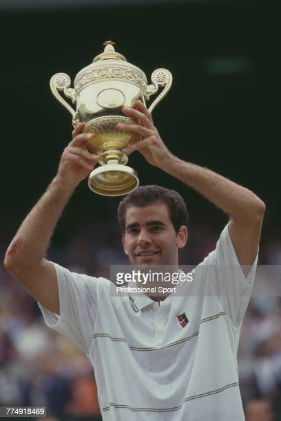 American tennis player Pete Sampras holds the Gentlemen's Singles trophy up in the air after beating fellow American Andre Agassi 63 64 75 in the...