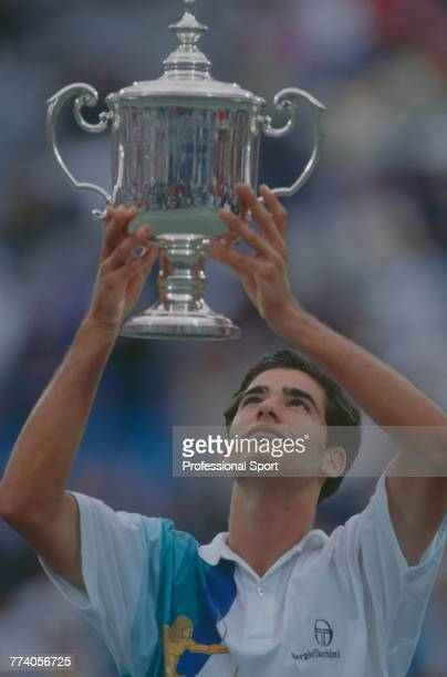 American tennis player Pete Sampras holds the trophy in the air after beating Andre Agassi 64 63 62 in the final of the Men's Singles tennis...