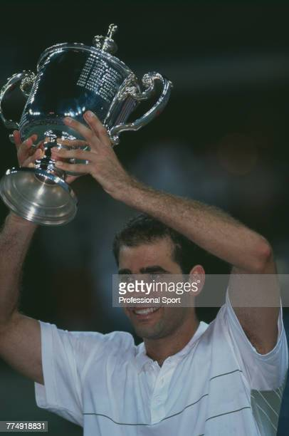 American tennis player Pete Sampras holds the trophy in the air after beating fellow American tennis player Andre Agassi 63 64 57 64 in the final of...