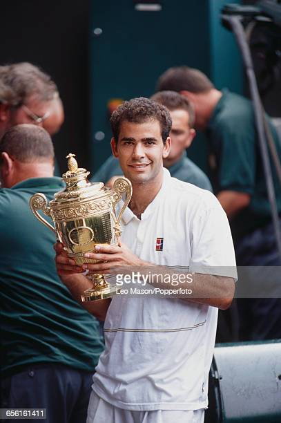 American tennis player Pete Sampras pictured holding the Gentlemen's Singles Trophy after defeating Andre Agassi to win the final of the Men's...