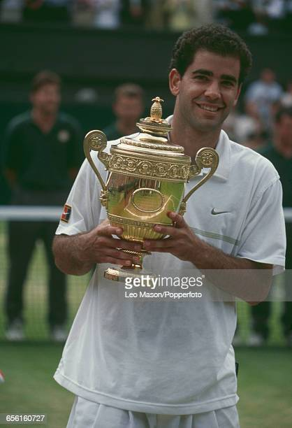 American tennis player Pete Sampras pictured raising the Gentlemen's Singles Trophy in the air after defeating Andre Agassi to win the final of the...