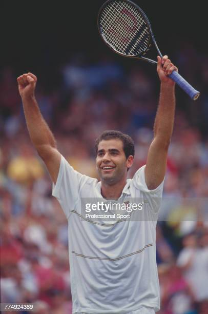 American tennis player Pete Sampras raises his arms in the air after beating fellow American Andre Agassi 63 64 75 in the final of the Men's Singles...