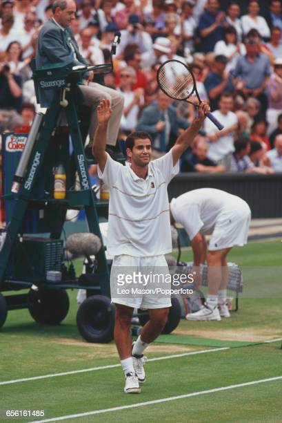 American tennis player Pete Sampras raises his arms in the air in celebration after defeating Andre Agassi to win the final of the Men's Singles...