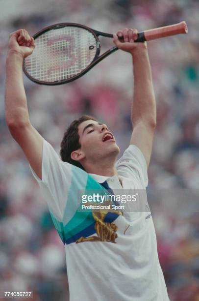 American tennis player Pete Sampras raises his arms in the air in celebration after beating Andre Agassi 64 63 62 in the final of the Men's Singles...