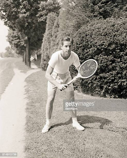 American tennis player Robert L Bobby Riggs strikes a pose at Westchester Country Club in Rye New York He is shown off court holding his racquet...