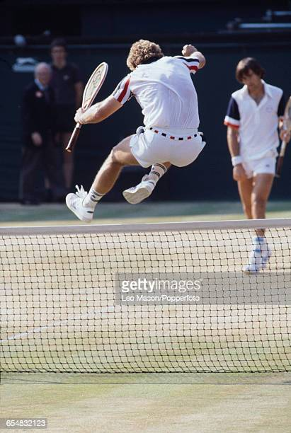 American tennis player Roscoe Tanner pictured jumping over the net after defeating Pat Dupre in the semifinals to progress to reach the final of the...
