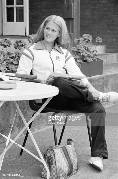 American tennis player Stacy Margolin, the girlfriend of American tennis player John McEnroe, waits to play tennis on the outdoor grass court at...