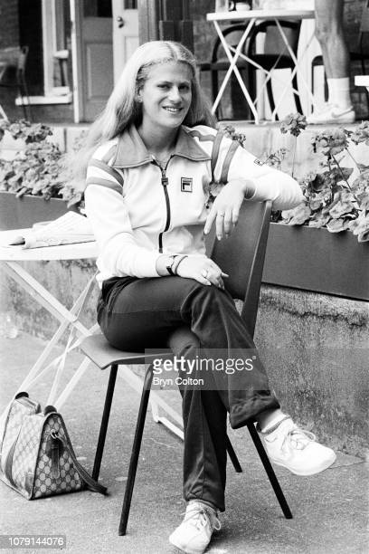 American tennis player Stacy Margolin the girlfriend of American tennis player John McEnroe waits to play tennis on the outdoor grass court at...