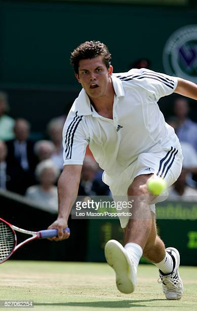 American tennis player Taylor Dent pictured in action returning the ball to Lleyton Hewitt of Australia in the fourth round of the Men's Singles...