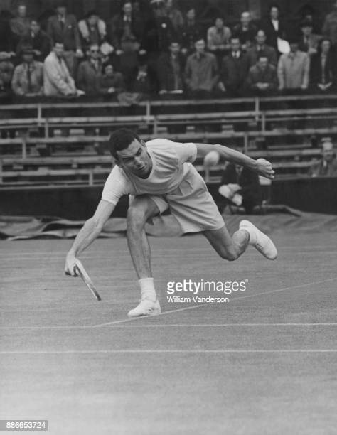 American tennis player Tom Brown during a match against Don Butler of Great Britain the first men's singles match on the Centre Court at Wimbledon...