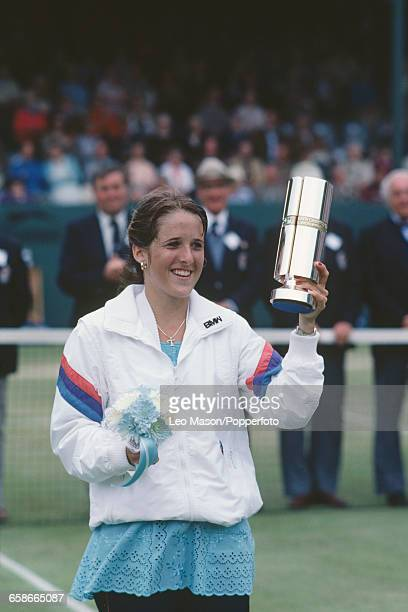 American tennis player Tracy Austin pictured holding the tournament trophy after winning the final of the 1981 BMW Championships Tennis tournament...