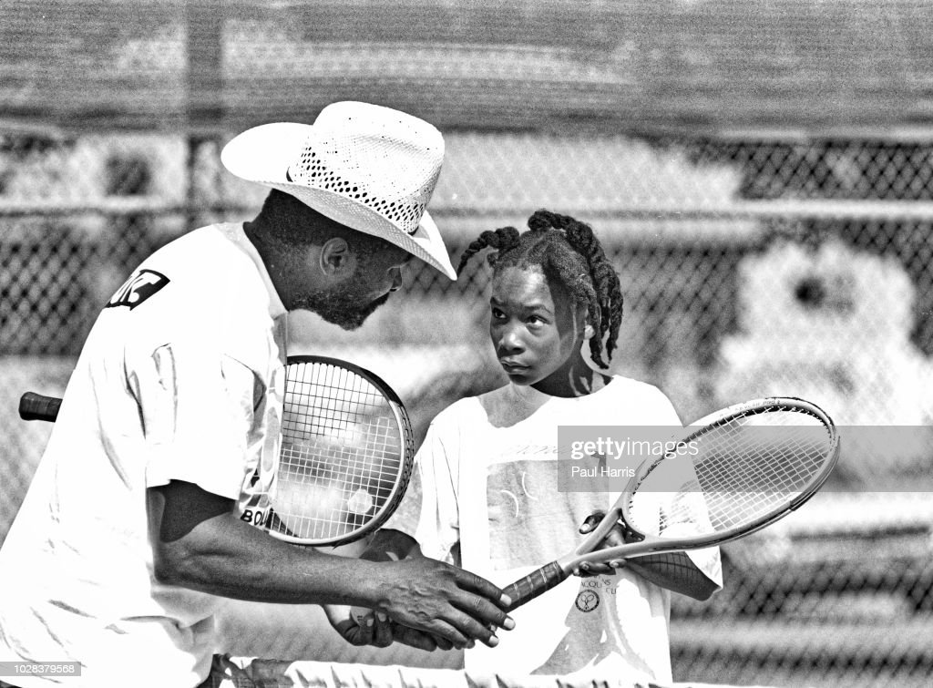 American tennis player Venus Williams, 11, listens to her father and coach, Richard Williams, during a training session at the Compton tennis courts, South Central Los Angeles, California, April 20 1991. Borth her and her sister, Serena, were coached by their father.