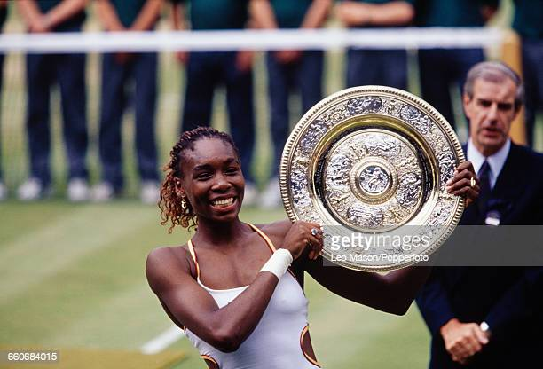 American tennis player Venus Williams pictured raising the Venus Rosewater Dish trophy in the air after winning the final of the Women's Singles...