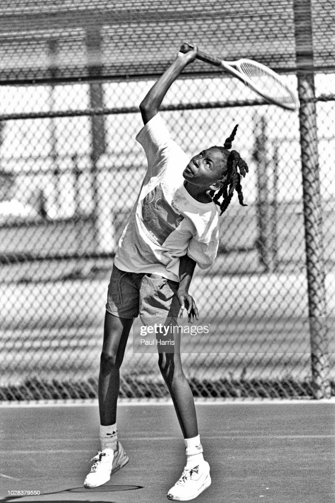American tennis player Venus Williams, 11, practices her serve during a training session at the Compton tennis courts, South Central Los Angeles, California, April 20 1991. Both her and her sister, Serena, were being coached by their father, Richard Williams.