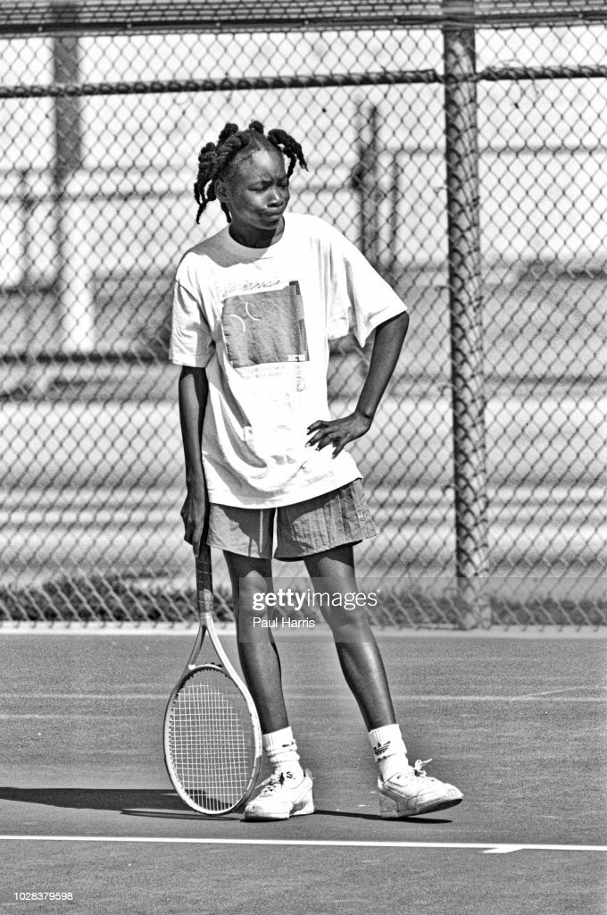 American tennis player Venus Williams, 11, stands with her hand on her hip after missing a serve during a training session at the Compton tennis courts, South Central Los Angeles, California, April 20 1991. Borth her and her sister, Serena, were being coached by their father, Richard Williams.