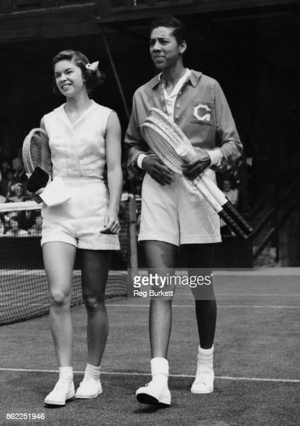 American tennis players Beverly Baker and Althea Gibson walk onto the court at Wimbledon London on the fifth day of the tournament 29th June 1951