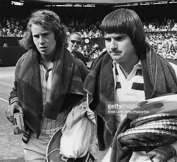 American tennis players John McEnroe and Jimmy Connors leaving the court after their Men's Singles semifinal at Wimbledon London 30th June 1977...