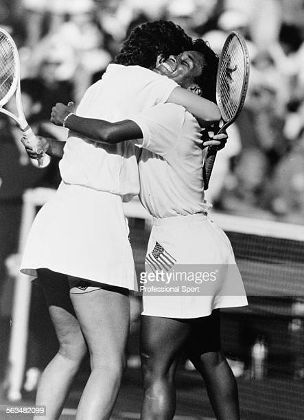 American tennis players Pam Shriver and Zina Garrison embrace after winning the gold medal in the Women's Doubles event at the Olympic Games in Seoul...