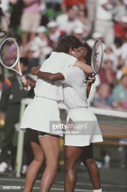 American tennis players Pam Shriver and Zina Garrison embrace after beating Jana Novotna and Helena Sukova of Czechoslovakia to win the gold medal...