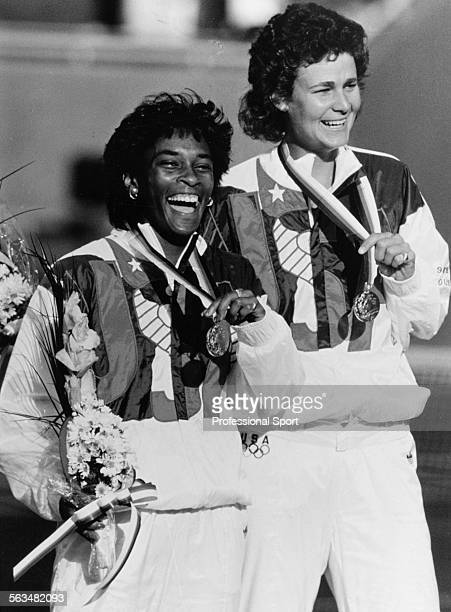 American tennis players Pam Shriver and Zina Garrison pictured together on the podium receiving their gold medal for winning the Women's Doubles...