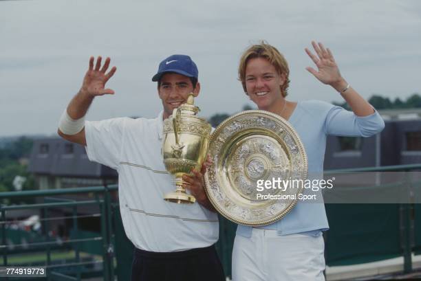 American tennis players Pete Sampras pictured left holding the Gentlemen's Singles Trophy and Lindsay Davenport holding the Venus Rosewater Dish...