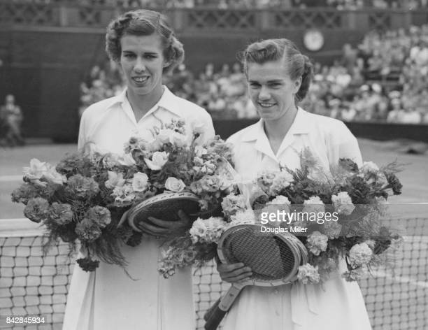American tennis players Shirley Fry and Doris Hart walk onto the court for the final of the Women's Singles at Wimbledon London 7th July 1951