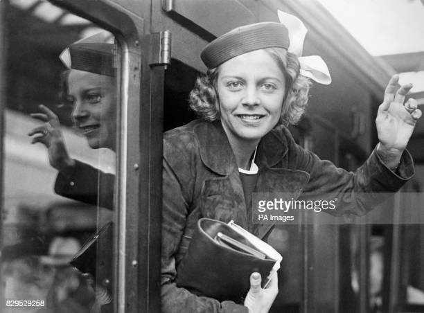 American tennis star Alice Marble waves out of her carriage window as she leaves London