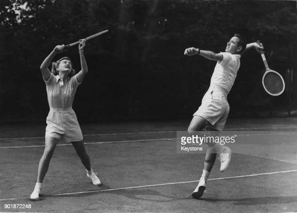 American tennis stars Bobby Riggs and Pauline Betz practising at Wembley in London before the professional lawn tennis tournament there 18th July 1947