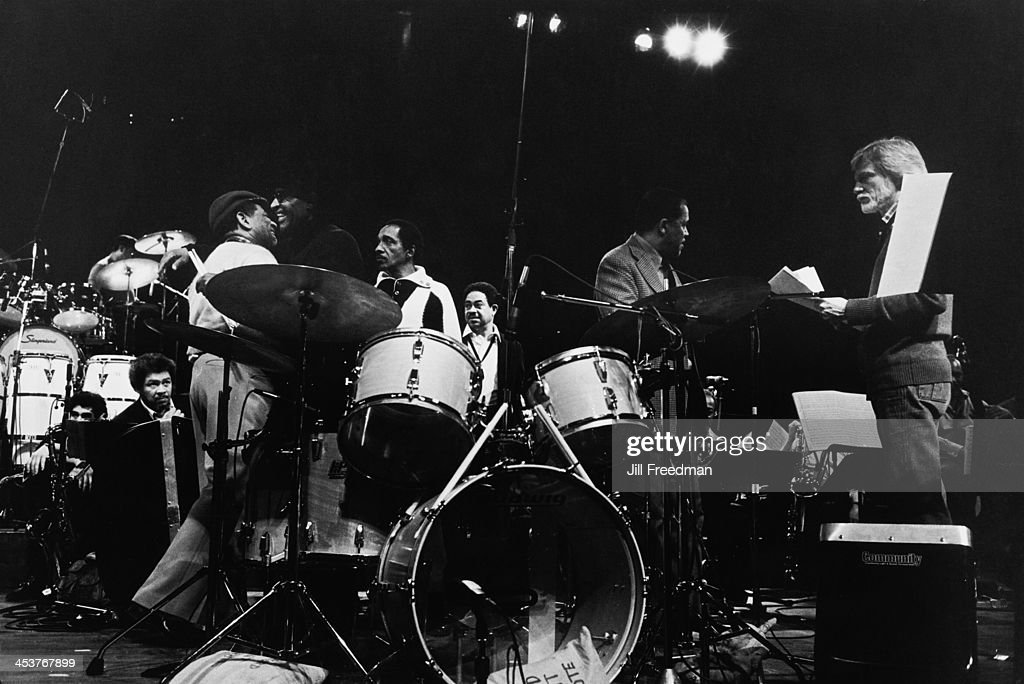 L - R; American tenor and soprano saxophonist Frank Foster (1928 - 2011), American jazz trumpeter and bandleader Dizzy Gillespie (1917 - 1993), American jazz percussionist and drummer Max Roach (1924 - 2007), American jazz vibraphonist Milt Jackson (1923 - 1999), American jazz saxophonist and flautist Frank Wess (1922 - 2013), American jazz pianist and musical director of the Modern Jazz Quartet John Lewis (1920 - 2001), and American jazz saxophonist Gerry Mulligan (1927 - 1996) during rehearsals for 'Dizzy Gillespie - Dream Band Jazz America', Carnegie Hall, New York City, 1981.