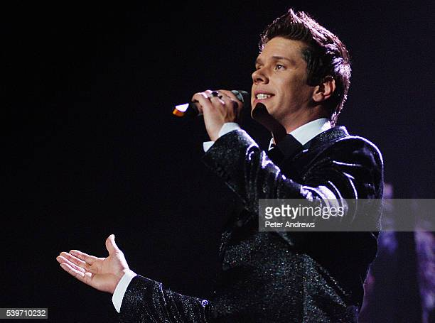 American Tenor David Miller of opera group Il Divo perform live on stage at the Wembley Arena London