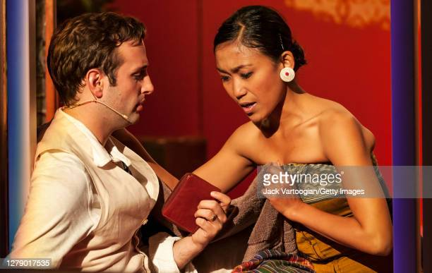 American tenor Peter Tantsits and Balinese dancer Kadek Dewi Aryani perform onstage during the final dress rehearsal of the Bang on a Can production...