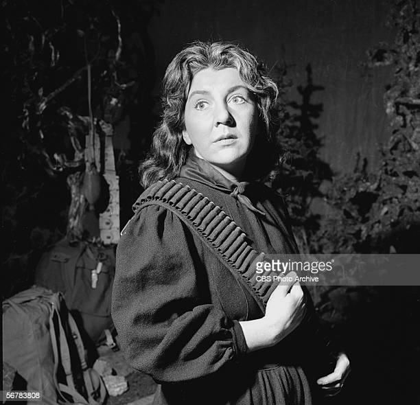 American theater and film actress Maureen Stapleton wears an ammunition belt in a still from the CBS television Playhouse 90 production of 'For Whom...