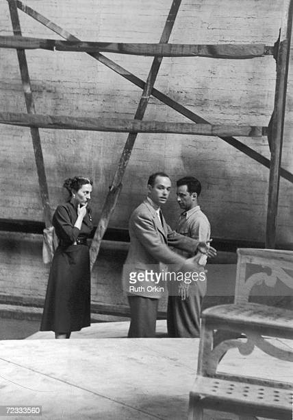 American theater producer Irene Mayer Selznick holds her chin an looks at an unidentified man as Turkish-born Greek American director Elia Kazan...