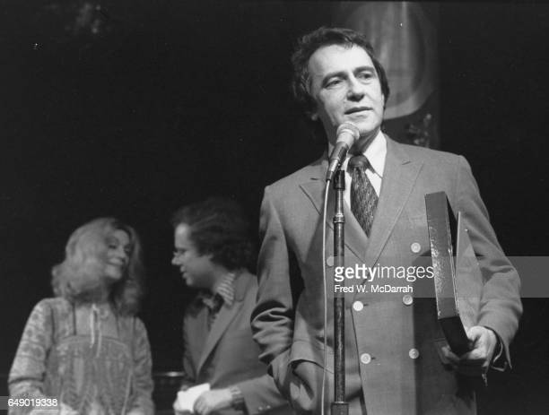 American theatre impresario Joe Papp speaks at the Village Voice's annual OBIE Awards New York New York May 21 1973 Behind him is the event's host...