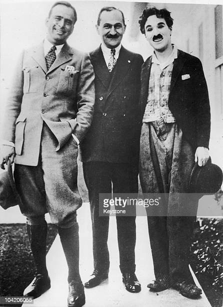 American theatrical agent William Morris with two of his bestknown signings American actor Douglas Fairbanks Sr and English comic actor Charlie...