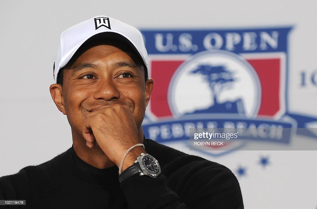 American Tiger Woods speaks at a press conference on the second practice day prior to the start of the 110th U.S. Open at Pebble Beach Golf Links at the US Open golf championship in Pebble Beach, California on June 15, 2010. AFP PHOTO / Robyn Beck