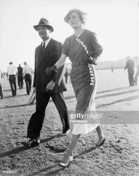 American tobacco heiress and philanthropist Doris Duke walks toward the East vs West Polo Match Meadowbrook Club Westbury Long Island New York 1934